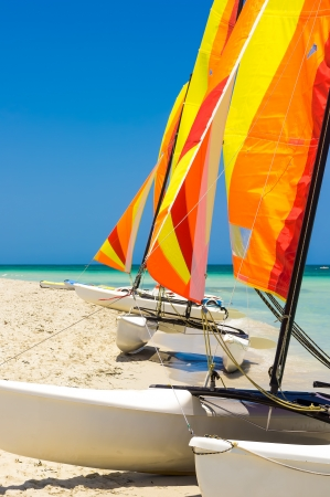 Catamarans with colorful sails on the shore of Varadero beach in Cuba