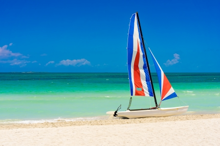 Colorful sailing boat on the white sands of Varadero beach in Cuba