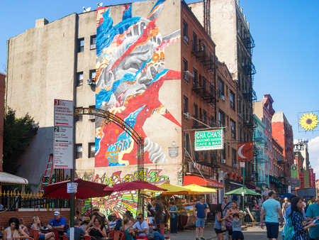 View of Little Italy in New York with a graffiti of the Statue of Liberty