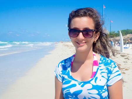 Pretty teenage girl at beautiful Varadero beach in Cuba