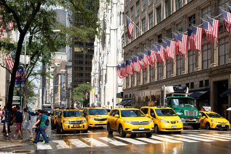 Yellow cabs next to Saint Patrick's Cathedral and Saks Fifth Avenue in New York City