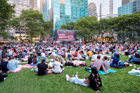Photo for Newyorkers and tourists enjoying the Bryant Park Summer Film Festival - Royalty Free Image