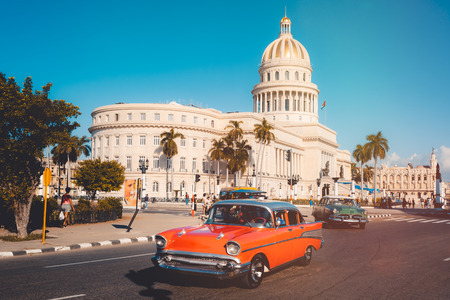 Photo for Colorful vintage cars next to the iconic Capitol building in Havana - Royalty Free Image