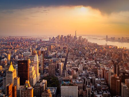 Photo pour Aerial view of New York City illuminated by the rising sun - image libre de droit