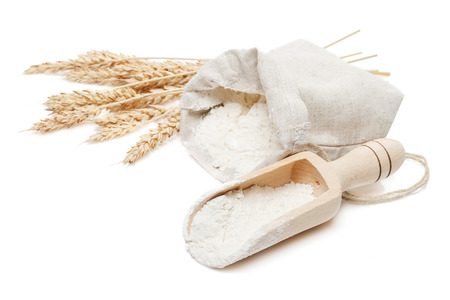 wheat in bag and scoop isolated on white background