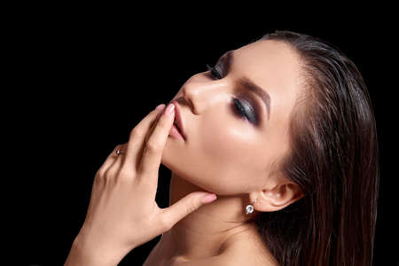 Photo pour Cosmetology. Portrait of beautiful woman with Fresh Skin and smokey eyes make-up. Isolated - image libre de droit