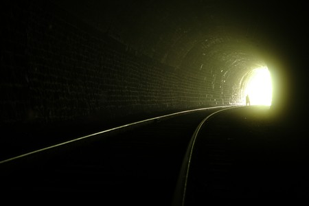 A silhouette near the exit from railroad tunnel