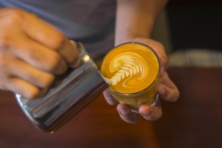 Latte art coffee by a Barista