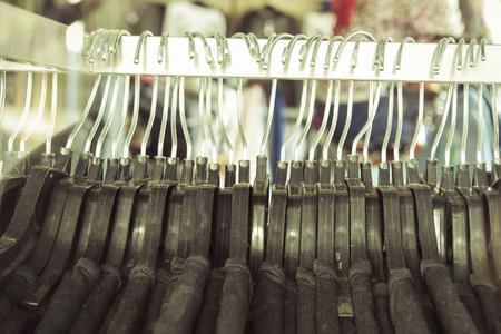 Old hanger with shirt in dress room , vintage color tone