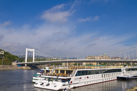 Budapest , Hungary - April 19 2012 :  Tourist riverboat on the Danube river