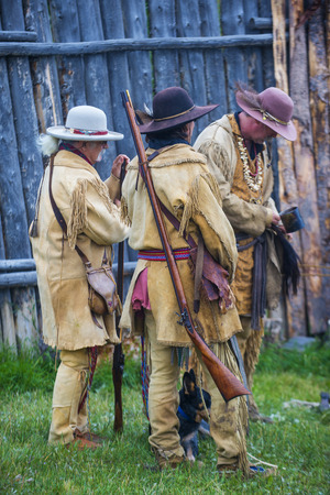 FORT BRIDGER , WYOMING - AUG 30 : Unidentified participants in the Fort Bridger Rendezvous held in Fort Bridger Wyoming on August 30 2014. Rendezvous is a mountain man celebration of the Fur Trade Era