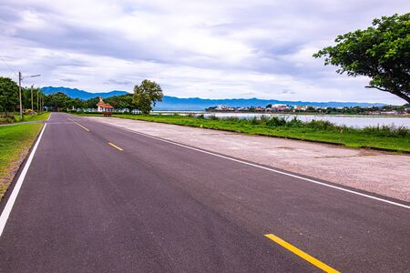 Photo for Road and running track beside Kwan Phayao lake, Thailand. - Royalty Free Image