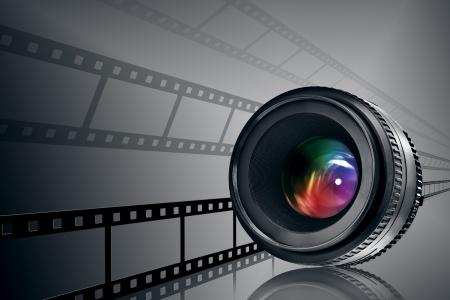 lens and film strip on black background