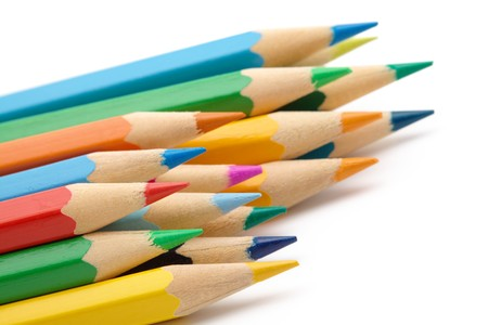 Sharp color crayons, shallow depth of field, isolated over white
