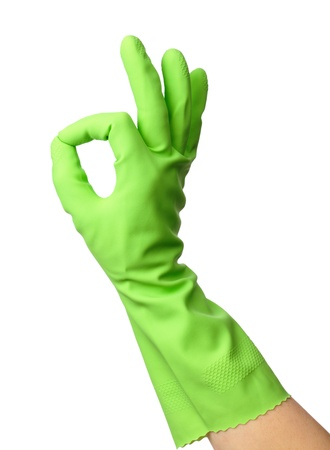 Hand wearing green rubber glove shows OK sign, isolated over white