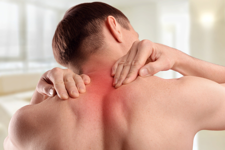 Injury of the cervical spine of a person. Pain in the neck and back. Rheumatism