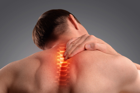 Pain in the cervical spine. Symptom of cervical chondrosis. Inflammation of the vertebra. Isolated on a gray background