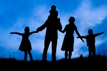 Photo for happy family by the sea on nature silhouette background - Royalty Free Image