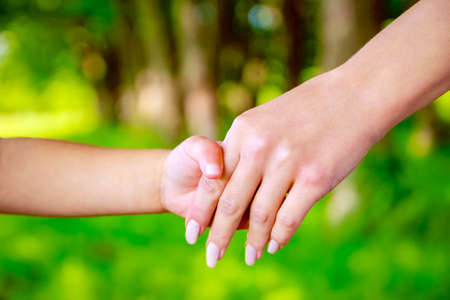 Photo for hands Happy parents and child outdoors in the park - Royalty Free Image