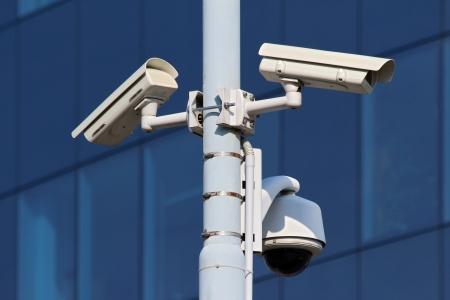 three cctv security cameras on street pylon