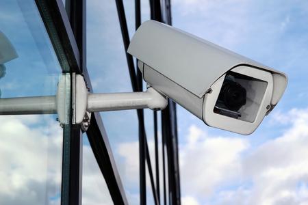 Digital CCTV camera on the glass facade