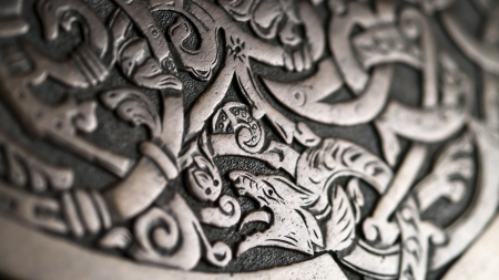 Viking wood carving depicting a wolf or a dragon, low depth of field