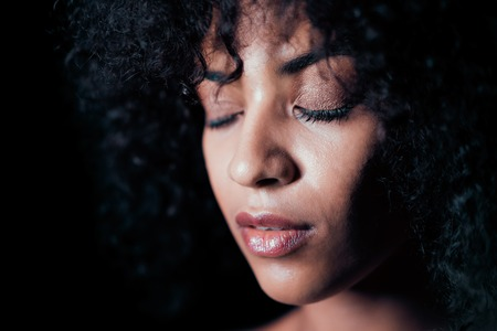 Photo pour Portrait of afro girl. Tempting woman with perfect makeup and curly hairstyle smiling. Glamour, fashion, model, healthy skin concept. Copy space. - image libre de droit