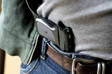 Tucked in a belt pistol being concealed