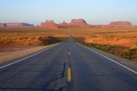 Long, straight road into Monument Valley,Utah