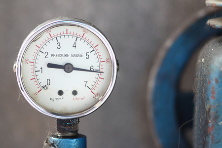 Close up pressure gauge with compressor working.