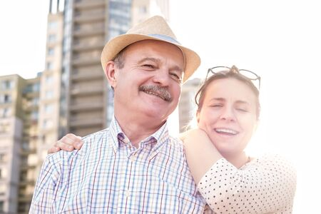 Foto per happy mature man smiling with young woman - Immagine Royalty Free