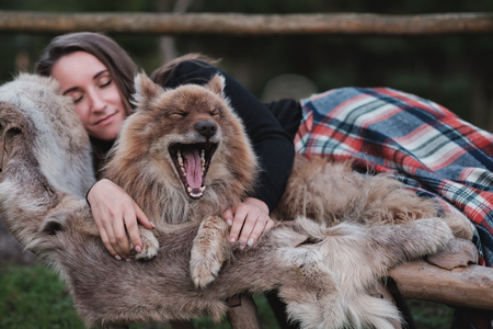 A beautiful woman and her dog nenets shepherd laika sleeping