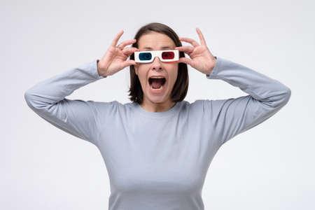Foto de Mature caucasian woman with 3d glasses watching movie. - Imagen libre de derechos