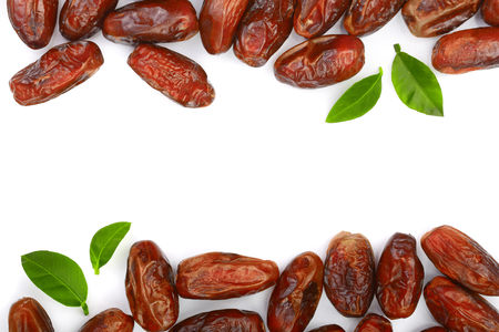 Photo for dry dates with green leaves isolated on white background with copy space for your text. Top view. Flat lay pattern. - Royalty Free Image