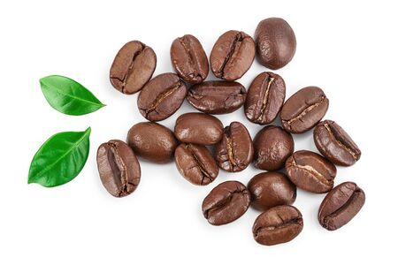 Photo pour Heap of roasted coffee beans with leaves isolated on white background. Top view. Flat lay. - image libre de droit