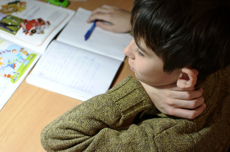 boy s doing homework