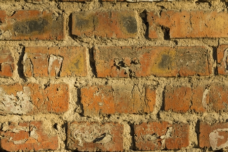 Old brick wall with cracks and scratches. Macro shot.