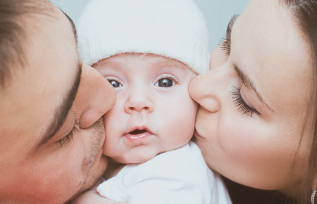 Photo pour Young mother and father with newborn - image libre de droit