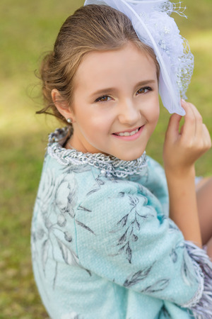 Pretty brown-eyed girl in a pretty vintage dress. Vintage style