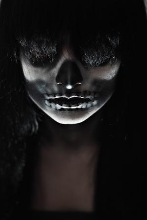 Gothic portrait of dead woman in studio