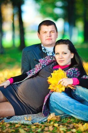 pregnant young woman with her husband