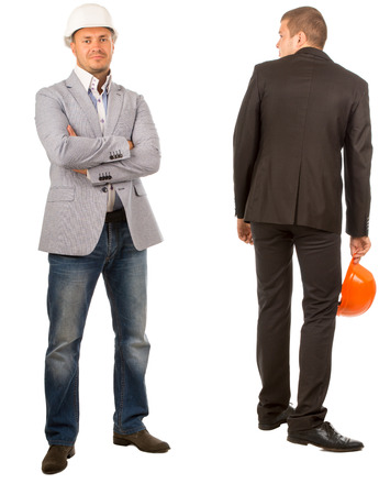 Two Male Middle Age Engineers, One is Looking at Camera While the Other is Facing Backward, on White Background