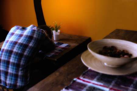 Man in a Mexican bar got drunk and fell asleep sitting alone on a chair at the table
