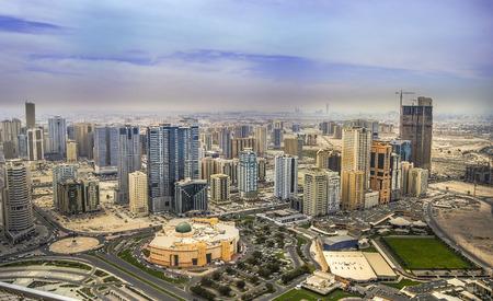 Panoramic sunset city skyline. Abu Dhabi attracts 10 million people annually.