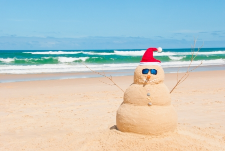 Snowman on holidays made out of sand instead of snow. Concept could be used for Global Warming & Christmas Cards
