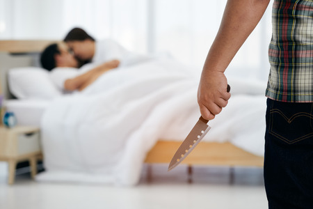 Photo pour Husband holding knife before killing wife and adulterer in bed room - image libre de droit