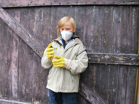 boy is spraying