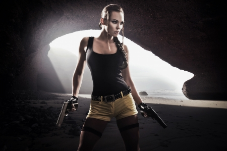 Photo for Young athletic woman with gun - Royalty Free Image