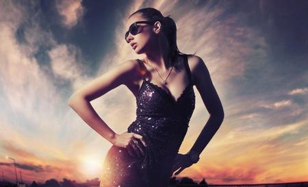 Perfect fashionable lady wearing sunglasses