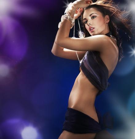 Pretty babe dancing in a nightclub